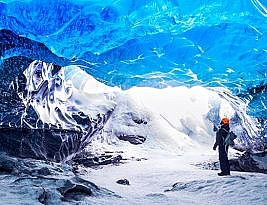Traveller Visiting Ice Cave With Amazing Eye-catching Scenes