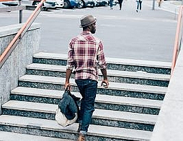 Young Handsome Afro Black Man Going Upstairs